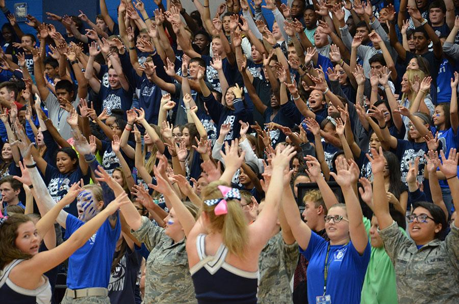 Hands+go+up+%5C%5C+Debuting+the+Raider+Rumble+Oct.+3+during+the+crosstown+showdown+pep+rally%2C+the+whole+student+body+participated.+%22I+cannot+believe+the+turn+out%2C%22+senior+cadet+Kelsie+Mathis+said.+%22It+is+amazing+what+the+Raider+Rumble+has+done+to+our+school+spirit.%22%0Aphoto+by+Caroline+Witty