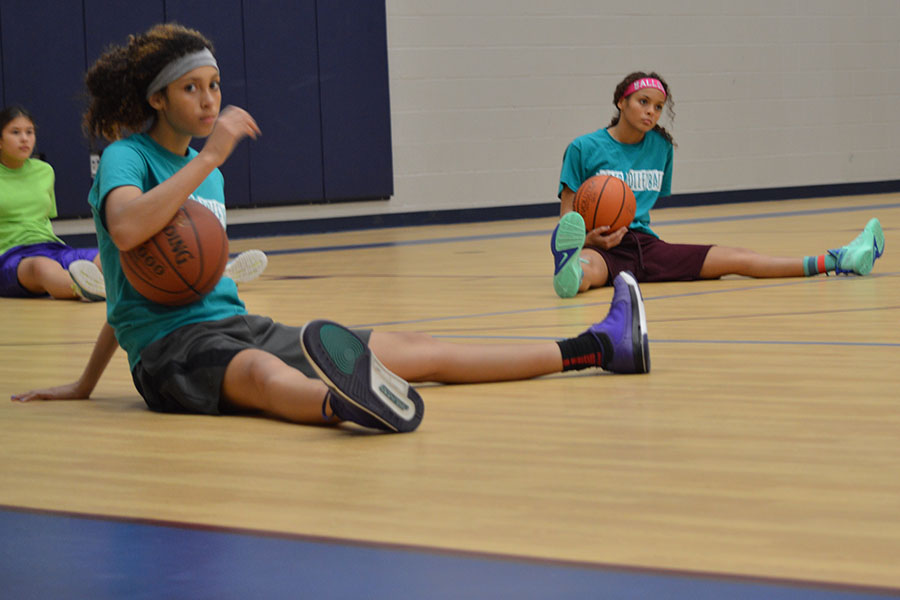 """lAl mxedi up \\ Freshman basketball player Sierra Banks does a double take when reading. """"I just try and try again every time I don't get something,"""" Banks said."""