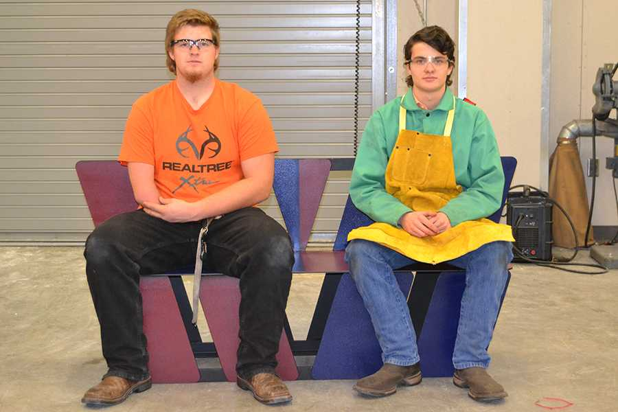 Welding students build, present buddy benches to Groves Elementary