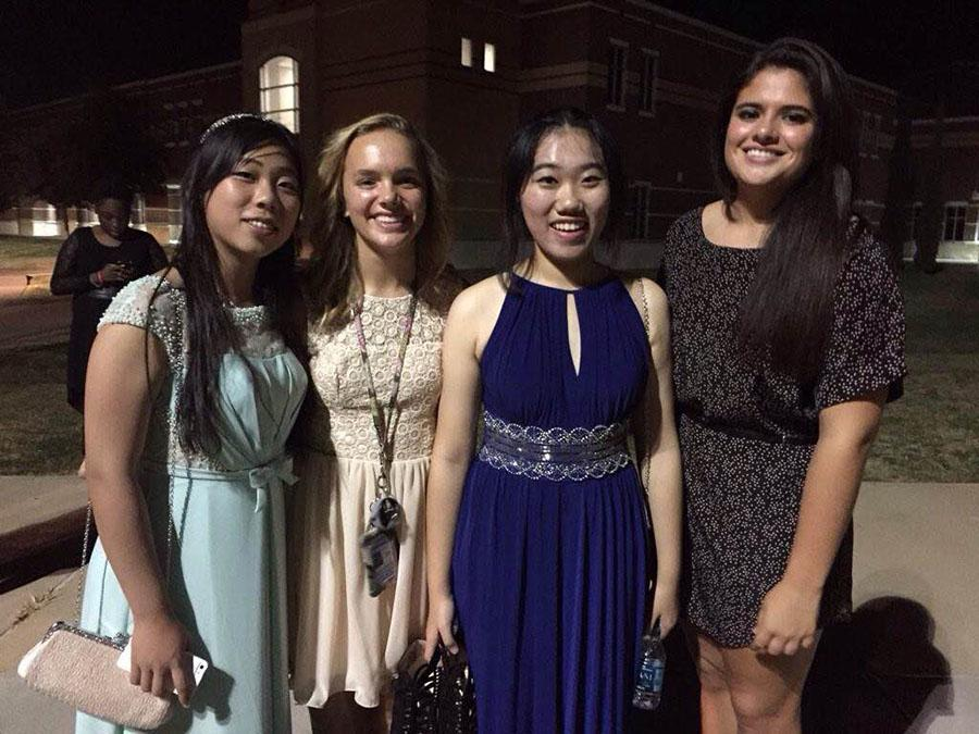 First+dance+%5C%5C+Foreign+exchange+students+attend+their+first+homecoming+dance.+From+left+to+right%3A+Chinese+exchange+student+Abigail+Qian%2C+her+host+sophomore+Greta+Williams%2C+Chinese+exchange+student+Amber+Zhang+and+junior+Maria+Sardo.