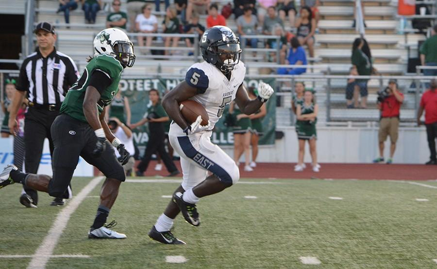 Sports day hero \\ Eno Benjamin, a junior on the varsity football team, runs the ball in for a touch down at the second season game against Mesquite Poteet, Benjamin and four other football players in DFW were nominated the following week to be