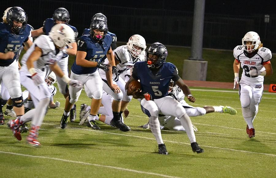 Running back \\ On the third possession with the ball, Runningback Eno Benjamin rushed for a 75 yard touchdown to put the game away against the Lovejoy Leopards, 42-28 Oct. 16.