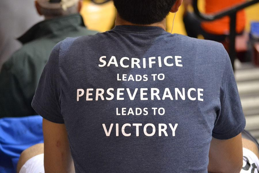 Sacrifice leads to Perseverance leads to Victory \\ Wrestling team quote on the back of the wrestling shirts.
