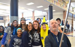 Say Go Raiders! \\ Fanatic competitors pose with Principal Mike Williams for a selfie. Students participating in the most spirited competition were called down during second period for judging.