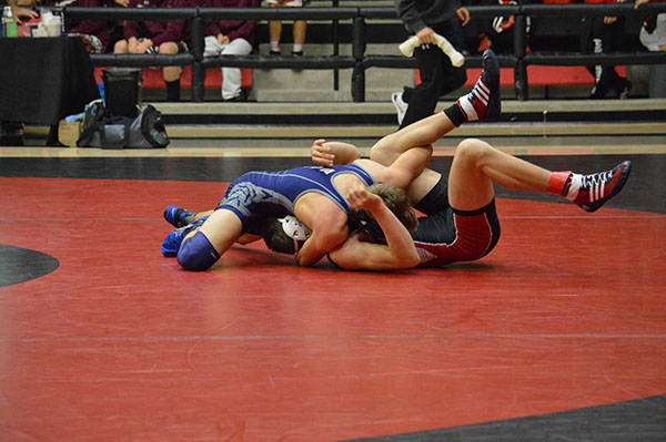 Get the pin \\ Junior Gabe Casey locks down his opponent in a pin, winning his first match of the day.