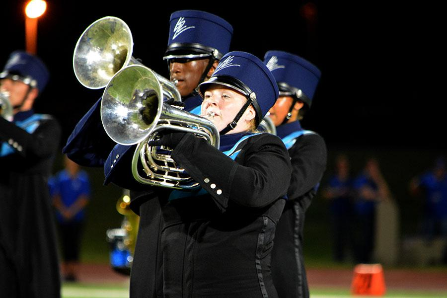 Horns up \\ Junior Ashlyn Stewart, French horn player, marches on Future Raider Night. With three different pieces of music and choreography to learn, the marching band is working to put all 68 sets of drill on the field.
