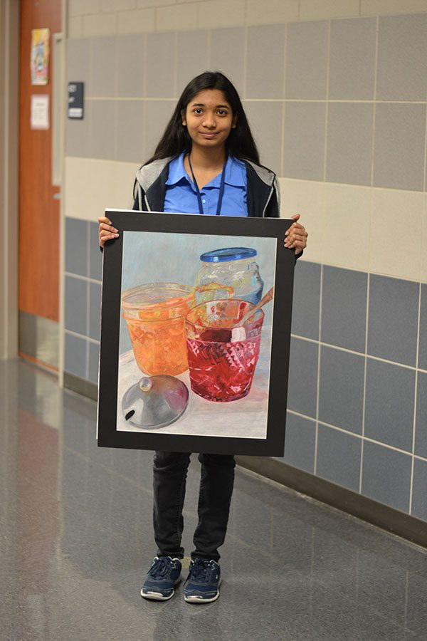 VASE+selectives+%2F%2F+Posing+for+pictures+freshman+Anika+Tasnim+shows+off+her+art+Feb.+18.%0A