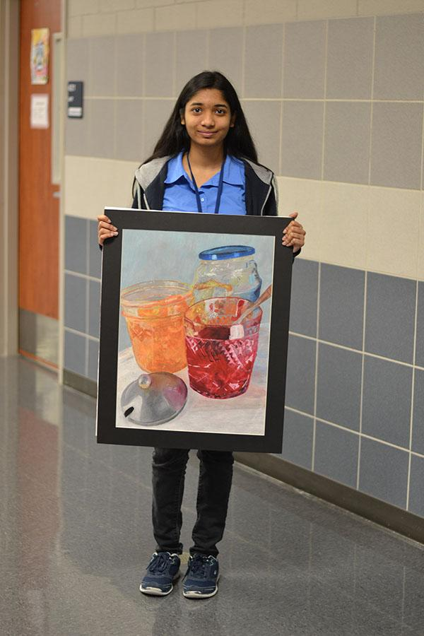 VASE selectives // Posing for pictures freshman Anika Tasnim shows off her art Feb. 18.