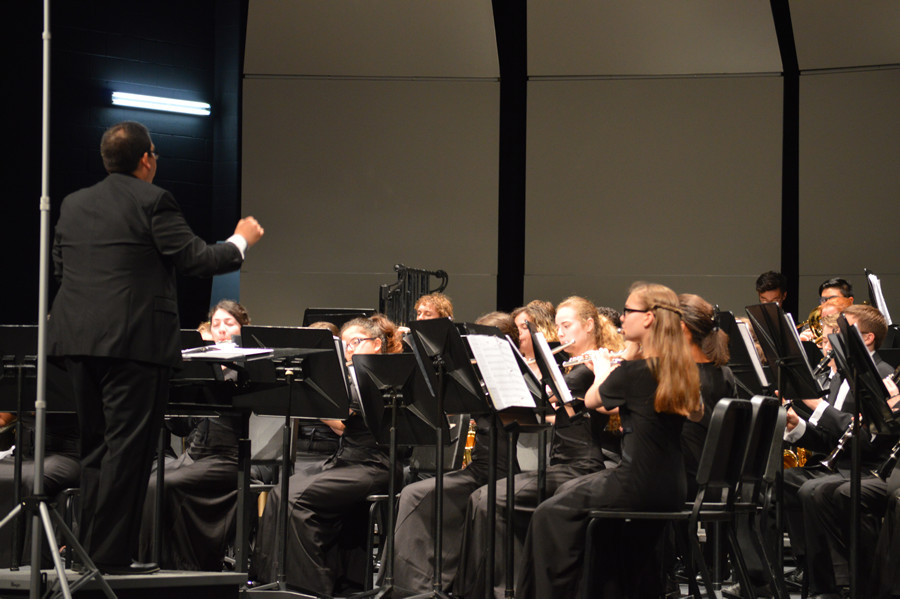 Celebrating the music \\ Conducting the band, Head Director Luis Saldaña guides the Symphonic band through the music during Celebrate the Arts. This is Saldañas final year at East. Frisco High School Band Director Gregory Hayes will take his spot as Head Band Director.