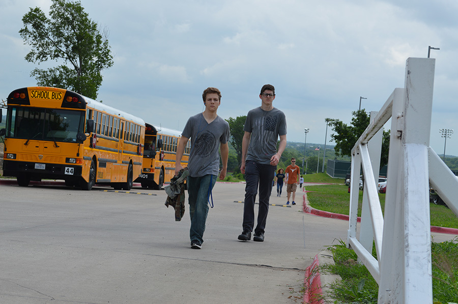 Walk with purpose \\ Honoring the prisoners of war of, The Bataan Death March through the start of a 14 mile walk, junior Ethan Metcalf and sophomore Robert Fredrichsen participate in their third period JROTC class.