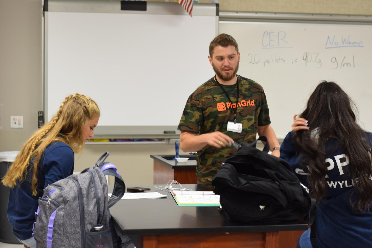 Head+of+the+class+%2F%2F+Teaching+chemical+measurements%2C+Mr.+Zach+Neu+is+a+first-year+teacher+and+a+former+Raider.