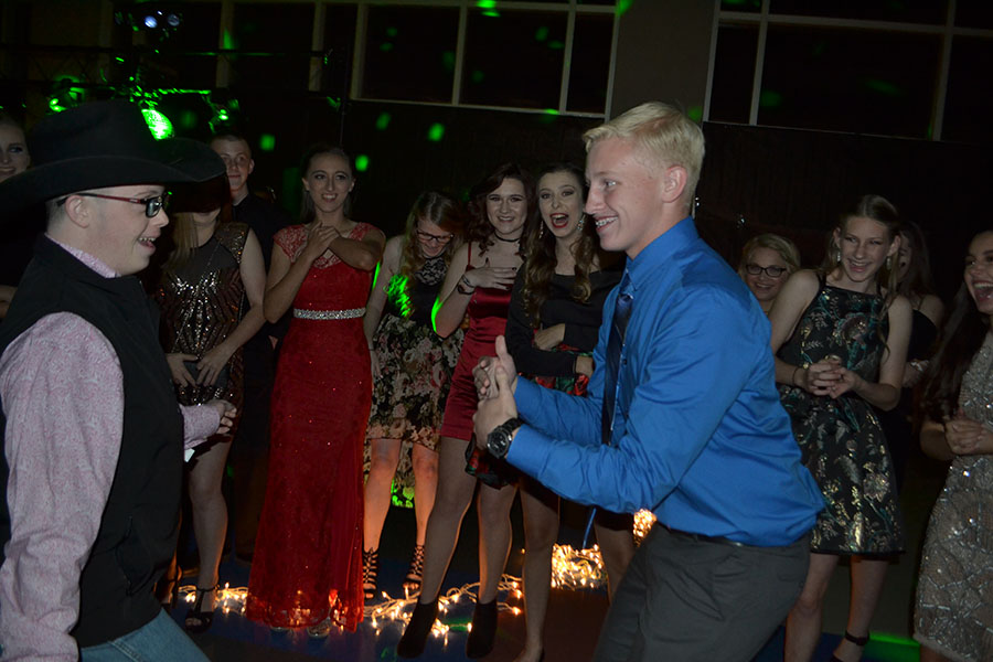 Dance the night away // Jamming out in the middle of a dance circle, sophomore T.K Gaykin and Junior Jordan Murphy attended the homecoming dance last year. Photo by Abby Cox