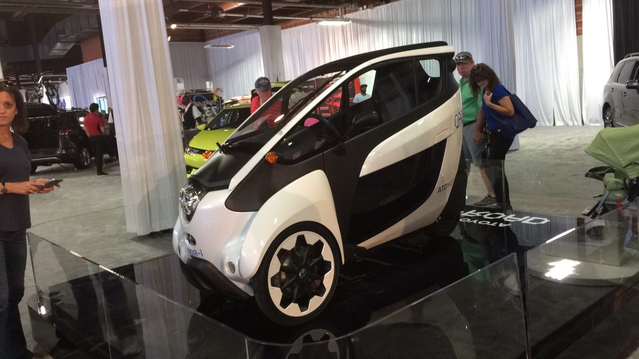 Toyota reveals one of its concept vehicles, the i-Road, a compact electric car designed for congested cities.