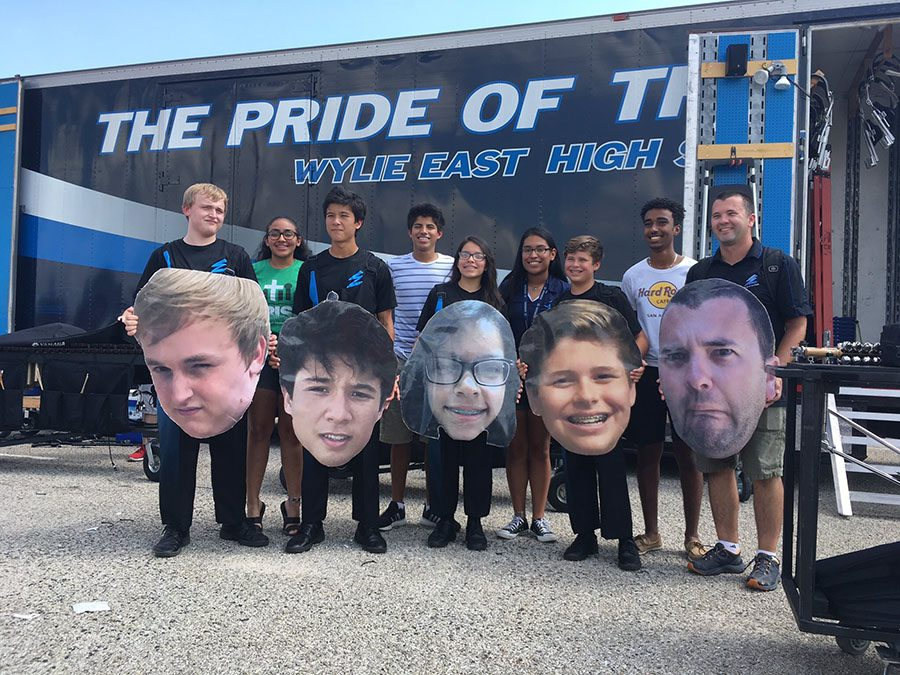 Family of Fat Heads // Posing with wide smiles, percussion members and friends beam in joy of receiving their Fat Heads Sept. 23.