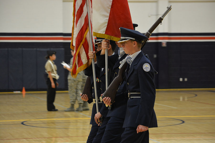 """Wheeling around // Completing a right wheel, freshman James """"JT"""" Red listens to Color Guard commander Austin Miller for the next commands at Billy Ryan High School Oct. 14."""