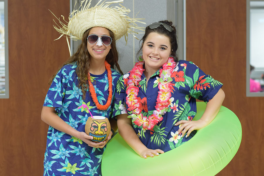 Spirit wear // Seniors Brianna Elder and Alexis Sturgeon dressed in their best beach attire on one of last year's homecoming spirit days.  Homecoming kicks off Oct. 23.