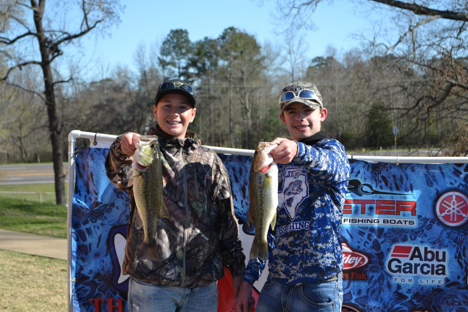 Pounds count // After waking early and spending the morning competing in the bass fishing tournament as a two-person team, sophomore Christian Conley and freshman J.T. Henry weighed in their fish at a competition Feb. 25 with a weight of 5.61 pounds. Photo by Ashley Henagin