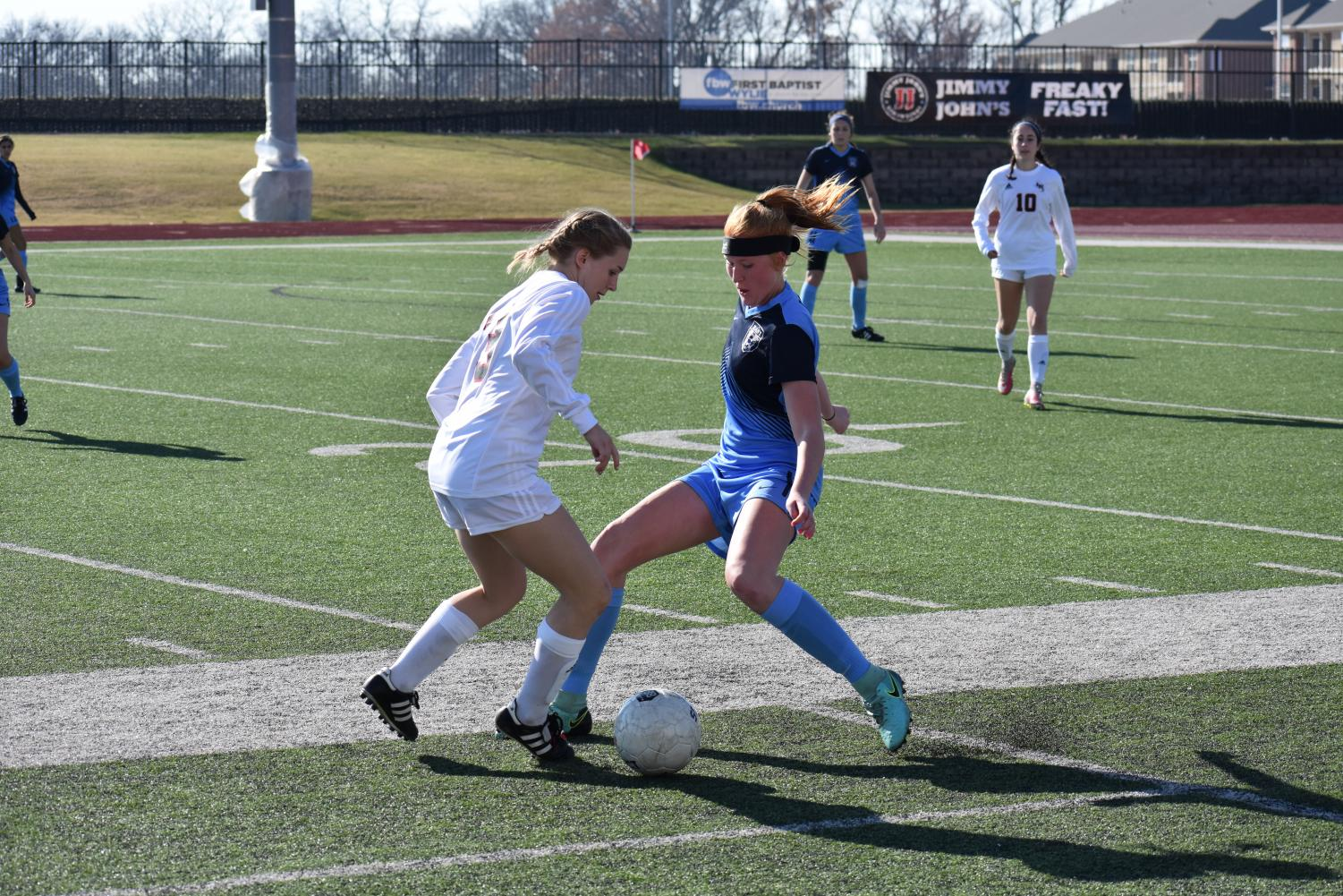 Defeating defender // Stopping a break away, junior Sam Springfield looks to gain possession against a Lake Highlands forward in the final game in the Andie-Studley Memorial showcase. The game ended in a 1-1 tie.
