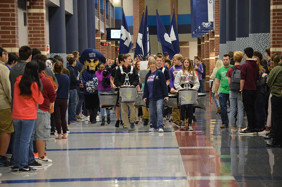 """Away to state \\ Getting recognized for heading to state, both athletes and scholars were celebrated during the send off Feb. 21. """"That's the first time I was actually inside the send off instead of being one who was cheering,"""