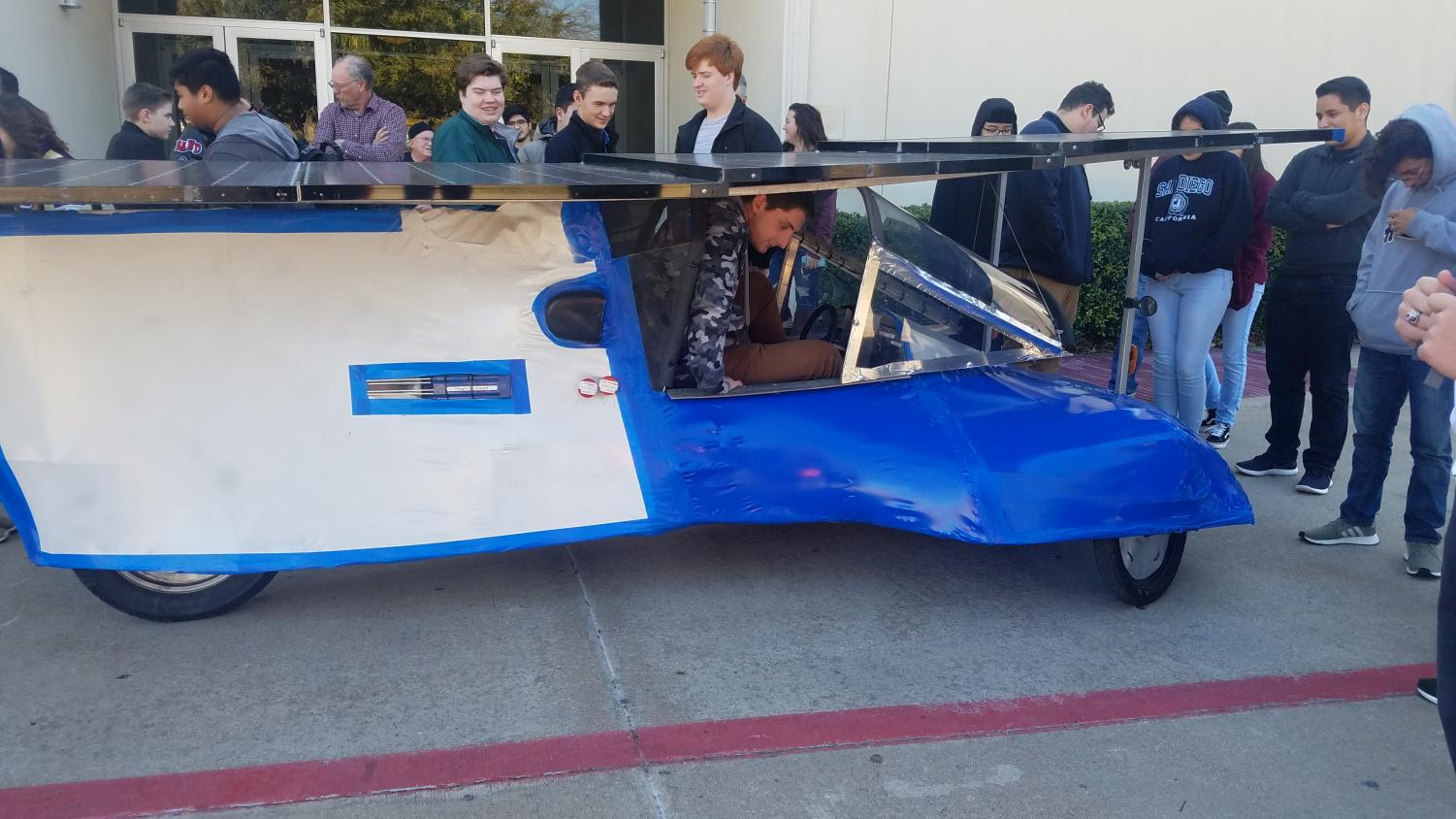 Showing off \\ While attending the annual specialty workshop Jan 13, the solar car team was able to show off last year's car to teams who will b participate in this year's Solar Car Challenge.