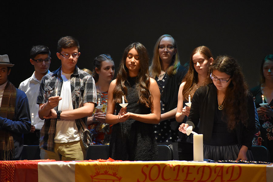 Lighting the way \\ Wylie East High School sophomore Brenna Reyes becomes a Spanish Honors Society member with this ritual April 12. La Sociedad Hispania inducted 32 members into the honor society. The prestigious organization is under the direction of Ms. Katharine Isbell and Ms. Jame Farrar.