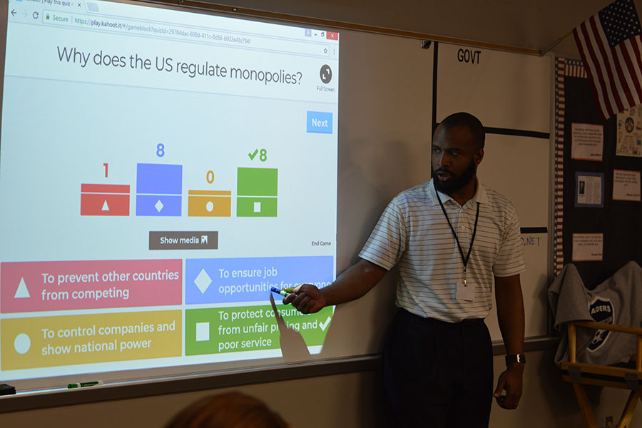Listen and learn // Reviewing for the upcoming government test, history teacher Mr. Levi Turner goes over the correct answers on the review using Kahoot to engage his students in class Feb. 17 during fourth period. The new teacher who has just joined the WEHS staff is a favorite among students.