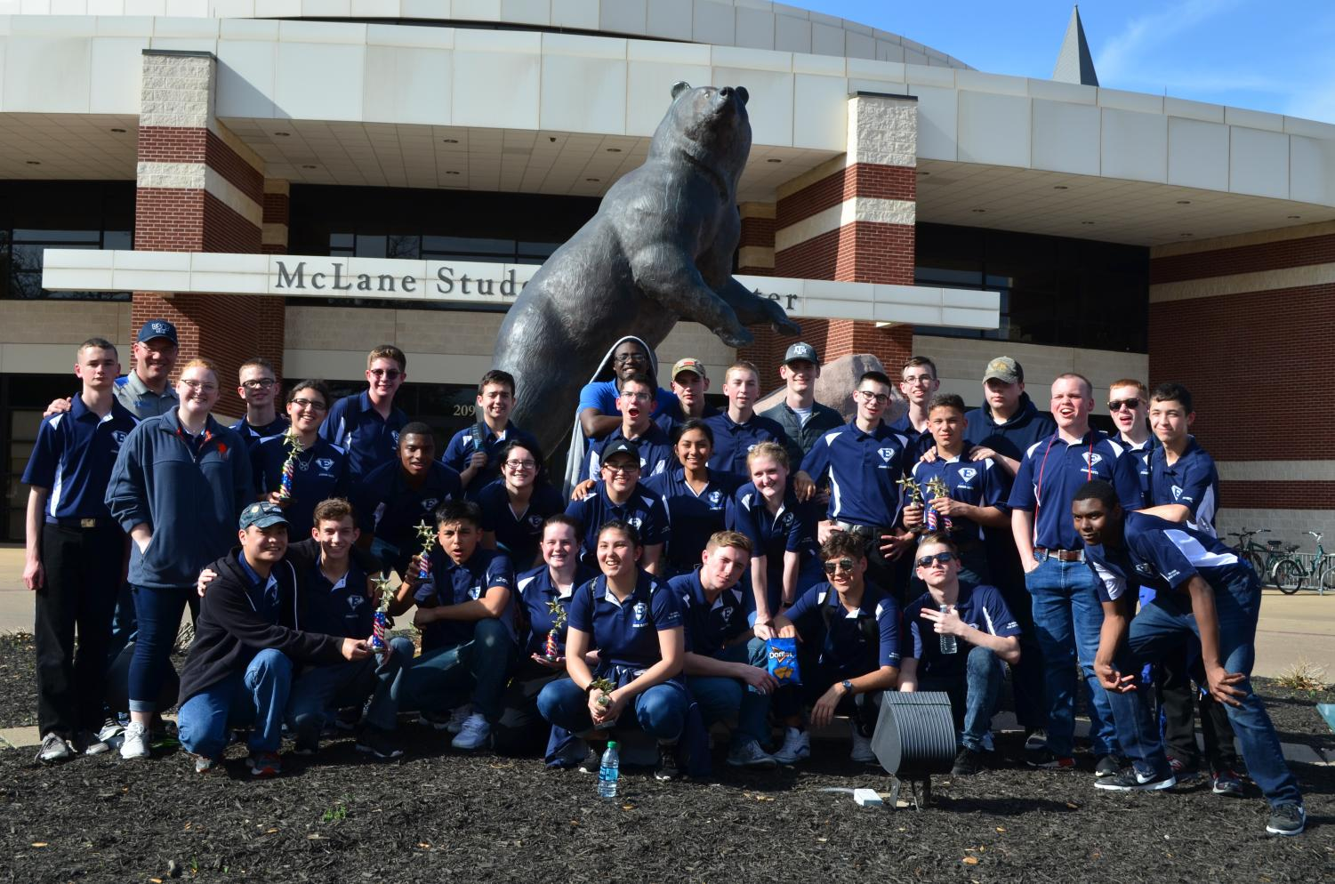 Grin and bear it \\ Completing their competition, AFJROTC poses in front of the infamous bear statue at Baylor University after being named the second overall champion at the second annual Baylor University Competition March 24.