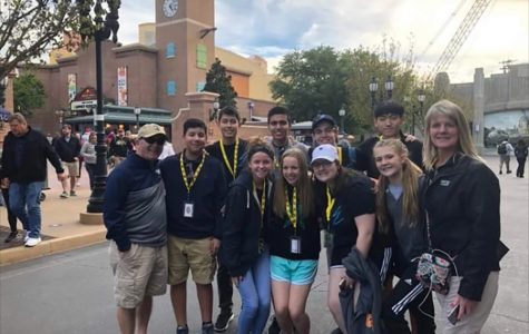 Starstruck students // During the first day in Florida, we went to Disney's Hollywood Studios. This park filled us with stardom and we even met the star himself, Principal Mike Williams. We snapped a quick photo before riding Star Tours with he and his wife. photo by Myra Williams.