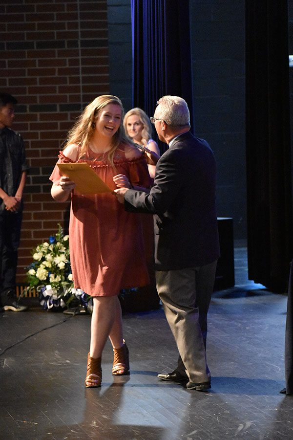 Last+laugh+%2F%2F+Junior+Jordan+Smith+smiles+as+she+accepts+the+Honor+Roll+certificate+from+Principal+Mike+Williams+at+the+Raiders+Excellence+Award+Ceremony+April+30.%0A