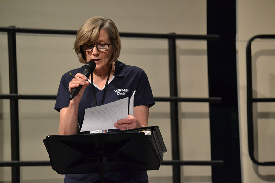 A sweet introduction // At the concert, Head Choir Director Mrs. Terry Berrier tells the audience what's in store for the Pop Mashup concert Jan. 23. This year is Mrs. Berrier's last year of teaching.