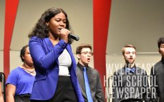 """Home for the holidays // Senior Kaylen Younger sings her solo to """"Please Come Home for Christmas"""" with Out of the Blue at the dress rehearsal for the choir Christmas concert, The Winter's Night Dec. 11."""