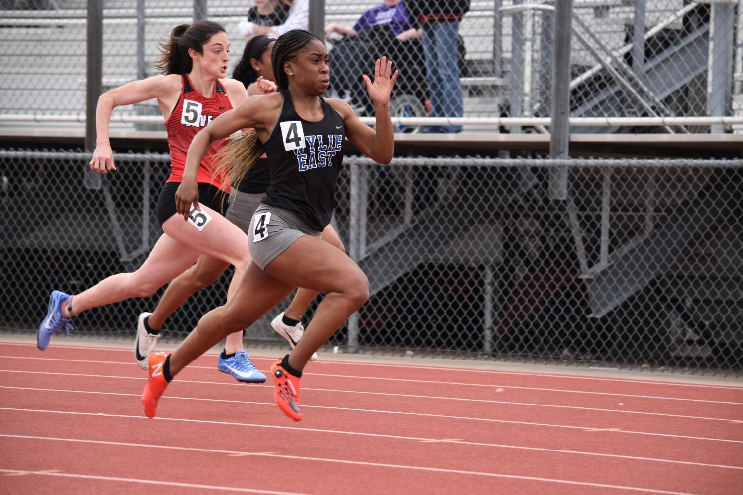 Fly+by+%2F%2F+Junior+Destini+Jeter+runs+during+the+District+10-5A+Track+%26+Field+Championship+meet+April+3.+Jeter+ran+her+300+meter+hurdles+race+in+42.36+and+will+be+advancing+to+the+Area+meet.