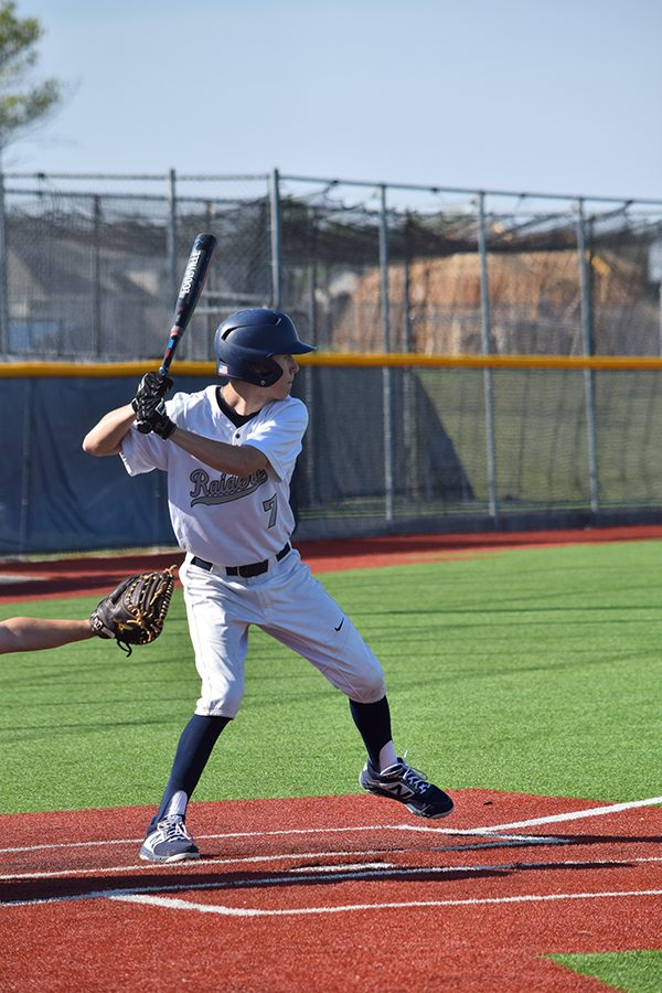 Hey batter batter \\ Hitting it to center field, sophomore Cade Adamson, sends two of his teammates home, winning the game against McKinney North April 6 with a score of 4-2.
