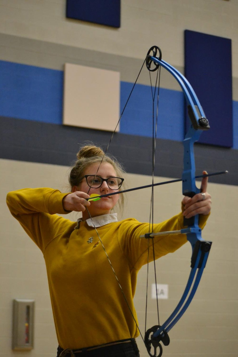 Eye+on+the+prize+%5C%5C+Aiming+at+her+target%2C+junior+Krista+Adams+practices+her+archery+skills.+The+archery+club+meets+every+Wednesday+during+Power+Hour.+Mr.+Chris+Bailey+sponsors+the+club+that+is+open+to+all+students.