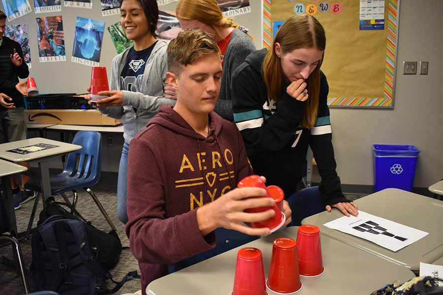 "Stacking dreams // Seniors Wylie Dunham and Emily Steigner work together on cup stacking in Mrs. Sharyn Vernon's English IV class during Wylie Way Day. This year's Wylie Way theme is ""Level Up"" with ""Game On"" as the theme of the Sept. 12 day. WISD is one of 153 districts to receive an overall score of an A in a new rating system."