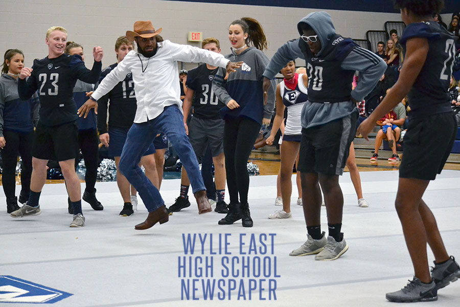 Cuttin a rug \\ Dressed in his western attire, stealing the show, psychology teacher Mr. Levi Turner dance battles other students at the dance off during the second pep rally of the year. The varsity football team was celebrated as they head off to play West Mesquite Sept. 27.