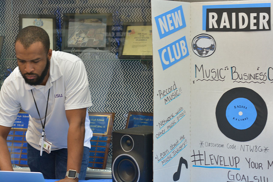 """Turner turns it up \\ During the school's first Rush Week hosted by student council, the Raider Records club looked for new members by advertising what they had to offer. This new organization, sponsored by Mr. Levi Turner, is another way for students to express themselves. """"I'm excited to see what this club does for students music wise,"""" Turner said."""