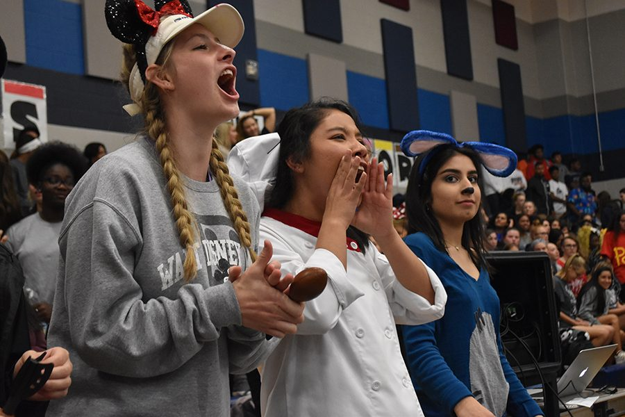 Dressed+to+the+nines+%2F%2F+Yelling+their+battle+cry%2C+seniors+Preslee+Waters%2C+Karla+Alvarez+and+Anisa+Hosseini+show+their+spirit+by+going+all+out+on+the+Disney+spirit+day+Oct.+12.+