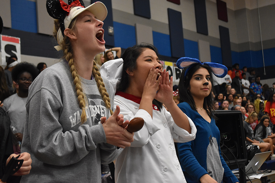 Dressed to the nines // Yelling their battle cry, seniors Preslee Waters, Karla Alvarez and Anisa Hosseini show their spirit by going all out on the Disney spirit day Oct. 12.