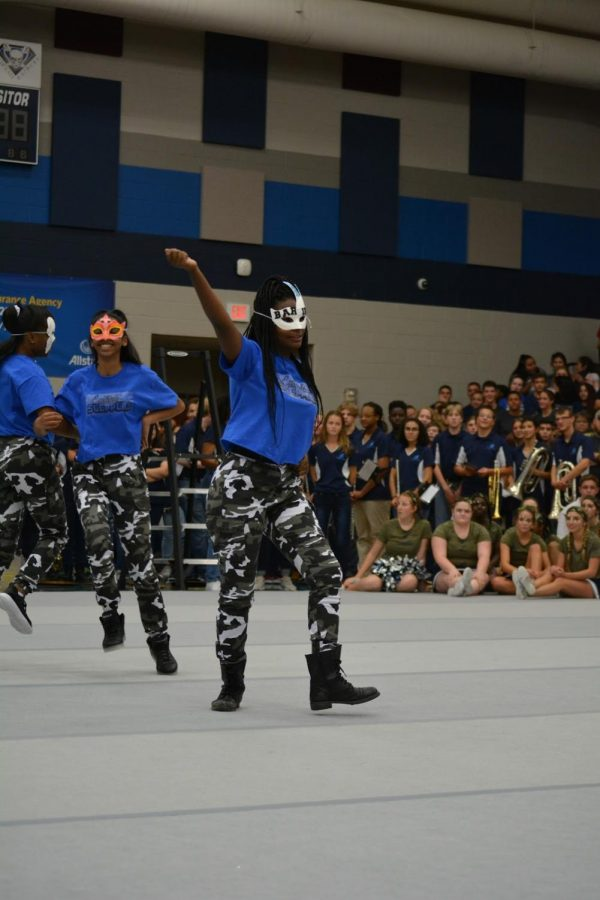 East Side Steppers// Dancing to the music, the step team makes its debut at the camo day pep rally Oct. 14.  Everyone who is interested in dance or making rhythm is encouraged to join. Visit with Mrs. Hollie Smith in room 318 for more information.