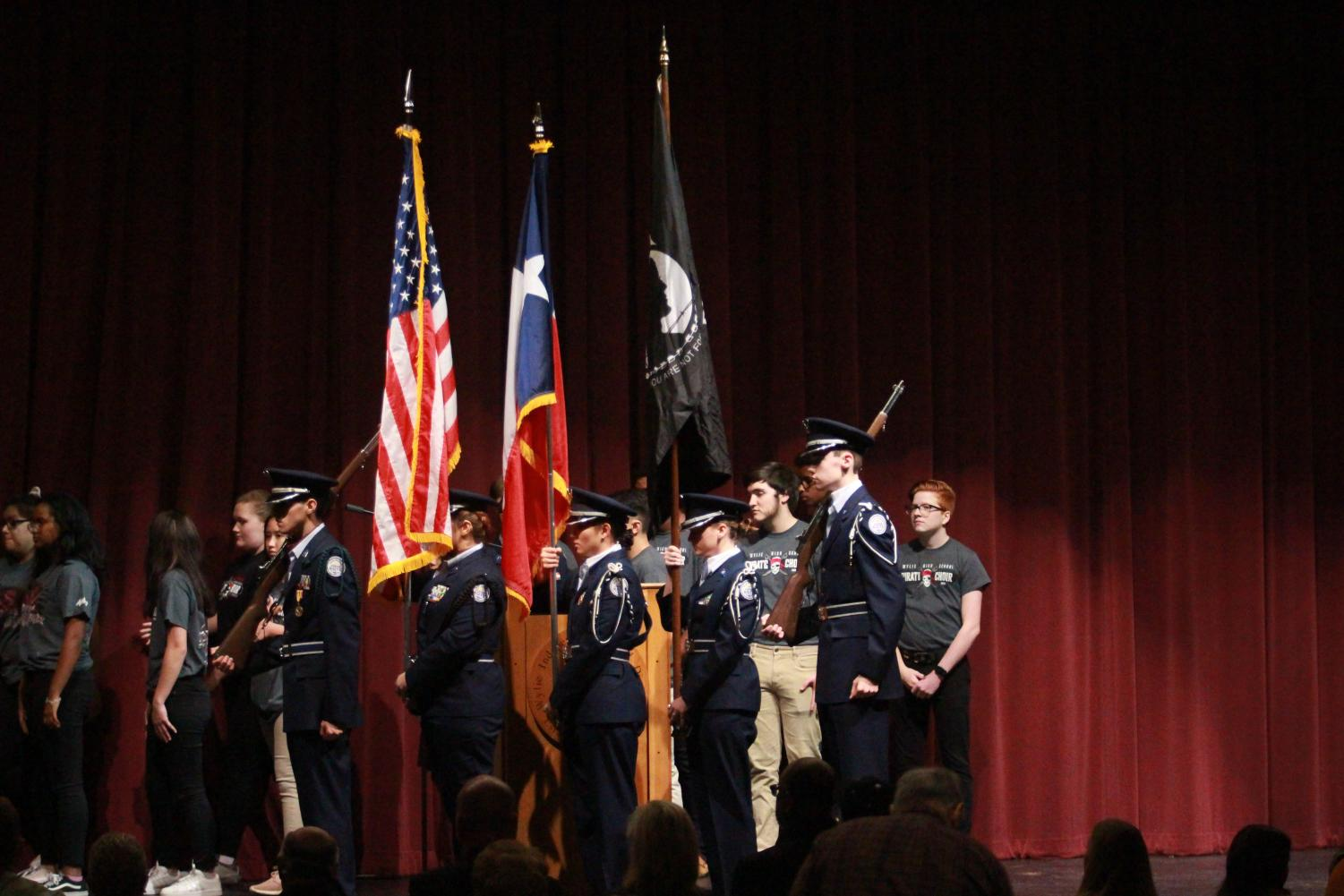 Change of scenery \ Cadets from both high schools honor veterans at the 18th annual Veterans Day Ceremony.  This year was the first time it was moved indoors due to inclement weather.