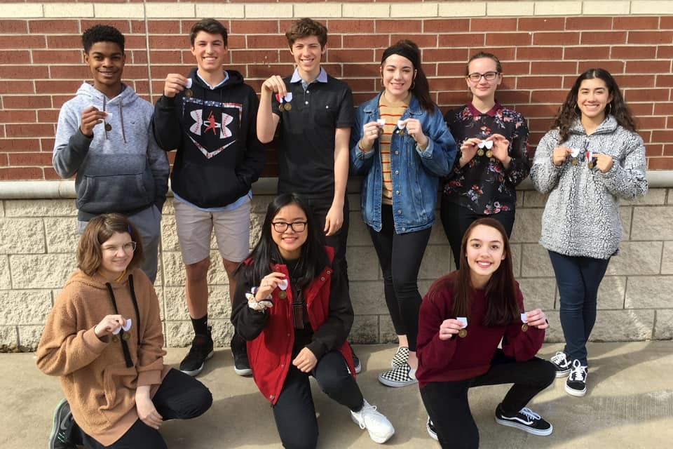 Achieving Artistry // Students in the first division show off their medals. The 70 art students won a total of 103 regional medals at Vase.