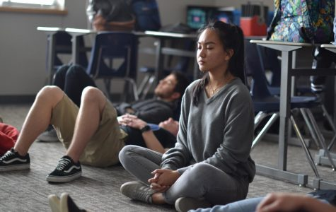 "Inhale, exhale \ Feeling calm and collected, senior Nikki Sibala is an active member in the new Yoga Club. Yoga Club meets on Wednesdays in room 916 during A lunch. ""I've been really stressed this week and Yoga Club has helped relieve me from some of it,"" Sibala said."