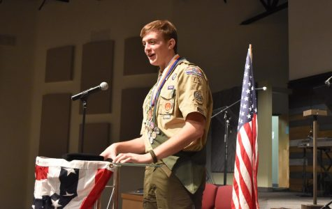 "Badged up // Covered in medals, senior Wylie Dunham expresses his gratitude to his family and friends as he receives his rank as Eagle Scout. Dunham has been a Boy Scout for six years and worked hard for the past two years to earn the title of Eagle Scout. ""All my time and hard work finally paid off and it's now going to benefit me in the future,"" Dunham said."
