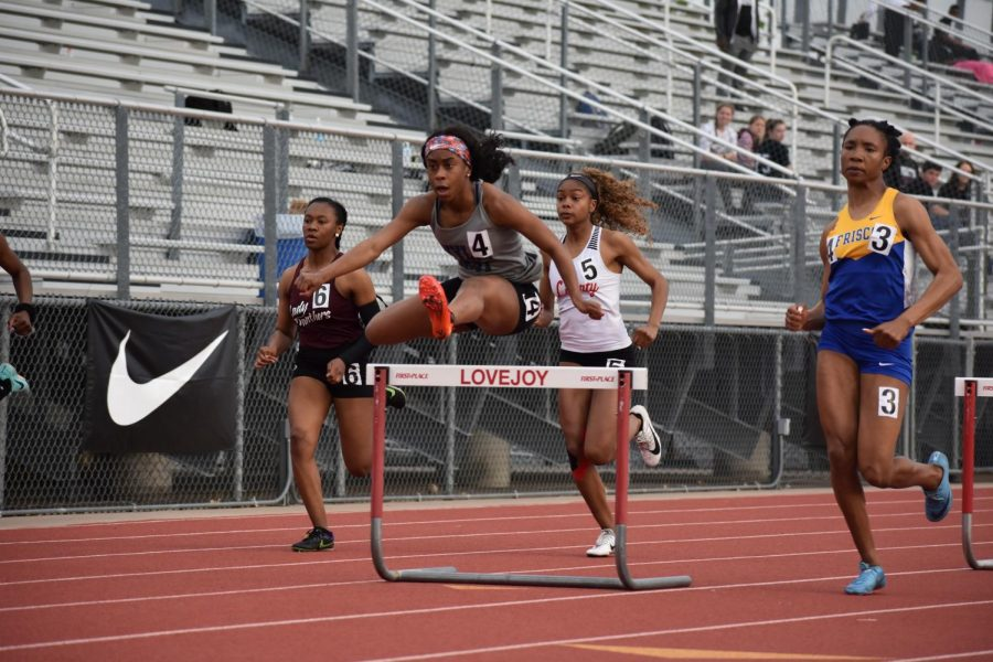 Leaps+and+bounds+%2F%2F+Junior+Destini+Jeter+becomes+the+girls%E2%80%99+300m+hurdles+Area+Champion+at+the+Area+Track+meet+held+in+the+Lovejoy+ISD+stadium.+Jeter+automatically+qualifies+for+the+Region+II-5A+Championship+meet+April+26-27.%0A