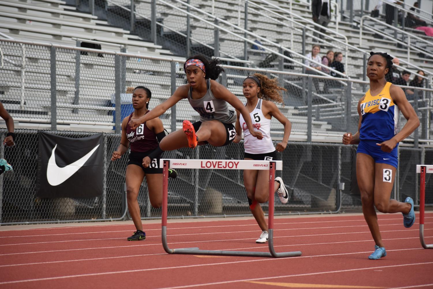 Leaps and bounds // Junior Destini Jeter becomes the girls' 300m hurdles Area Champion at the Area Track meet held in the Lovejoy ISD stadium. Jeter automatically qualifies for the Region II-5A Championship meet April 26-27.
