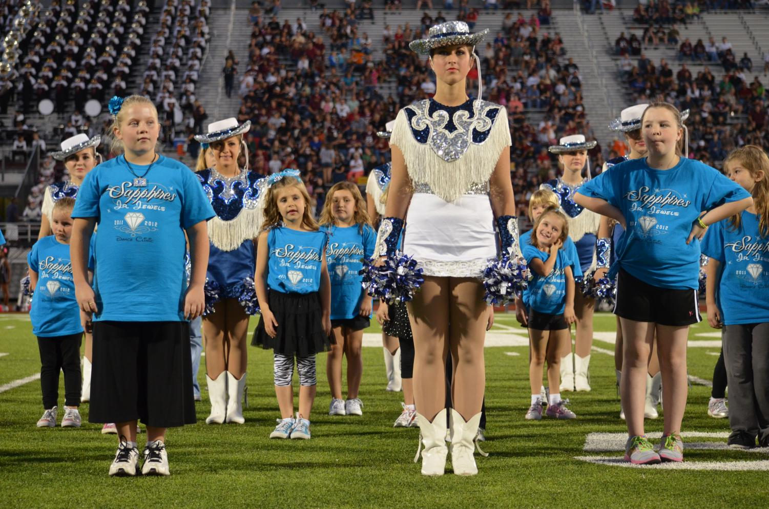 A look back \\ Little did journalism adviser Mrs. Casi Thedford know that the photo she was taking of her daughter seven years ago would be used to showcase current Sapphires when they attended the Junior Jewel clinic as young girls. Senior Jordan Smith, on the front row, far left, attended the same clinic and is now an officer on the drill team. See her 'before' and 'after' below.