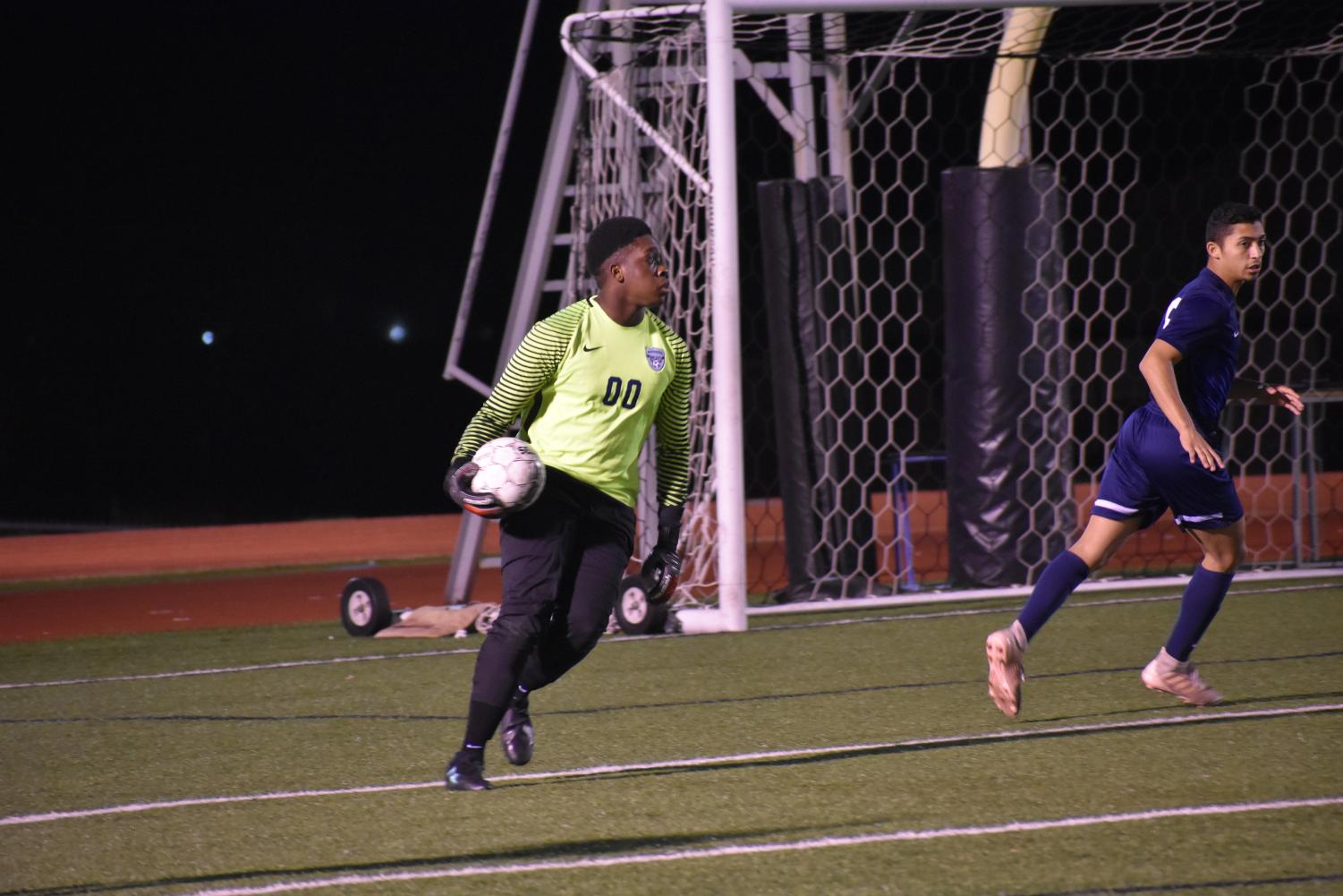 "He's a keeper // Hot on his feet, junior varsity goalie Maxwell Quaye scouts the field for his teammates during their game against Denison High School. The team won 7-0 and finished the regular season with an undefeated record. ""Winning game after game carried our momentum and gave us confidence,"" Quaye said."