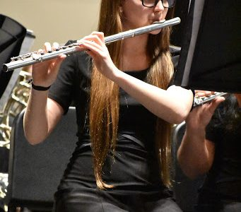 All ears \\ Senior flute player Elizabeth Forte plays in the pre-uil for Symphonic Band