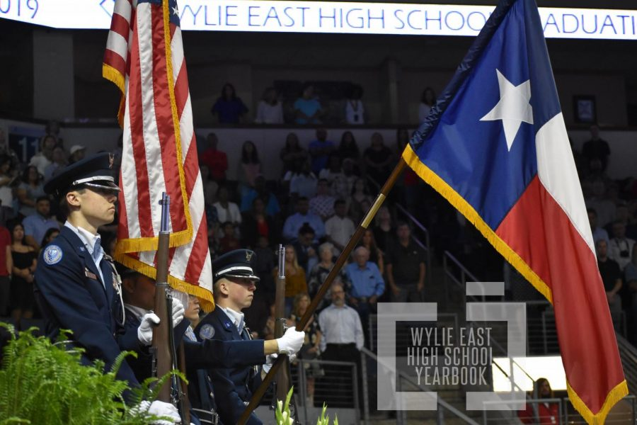 O say \\ JROTC color guard participated in the graduation ceremony by presenting the colors for the singing of the National Anthem.